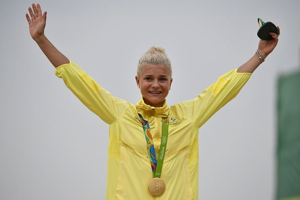 Gold medallist Sweden's Jenny Rissveds celebrates on the podium of the cycling mountain bike women's cross-country race of the Rio 2016 Olympic Games at the Mountain Bike Centre in Rio de Janeiro on August 20, 2016. / AFP / Pascal GUYOT        (Photo credit should read PASCAL GUYOT/AFP/Getty Images)