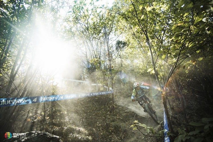 The light shines down on the enduro pope.